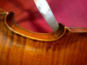 The opening of a belly of a nineteenth-century violin